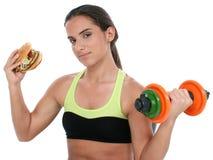 De mooie Kleurrijke Gewichten van de Holding van het Meisje van de Tiener en een ReuzeCheeseb stock foto