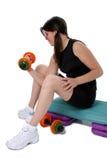 De mooie Kleurrijke Gewichten van de Holding van het Meisje van de Tiener over Wit Stock Foto