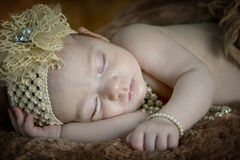 De mooie slaap van het babymeisje Stock Fotografie