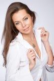 De mooie vrouw in een wit overhemd Royalty-vrije Stock Afbeelding