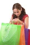 De mooie vrouw gaat winkelend Royalty-vrije Stock Foto's