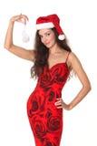 De mooie vrouw kleedde zich als Kerstman Royalty-vrije Stock Afbeeldingen