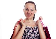 De mooie vrouw maakt het winkelen Stock Foto's