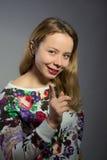De mooie vrouw toont emoties Royalty-vrije Stock Afbeeldingen