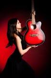 De mooie vrouw van trambestuurders met gitaar Royalty-vrije Stock Foto