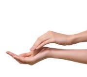 De mooie vrouwelijke handen zijn geïsoleerdt Stock Afbeelding