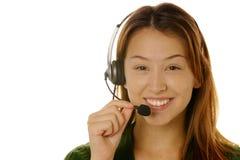 De mooie vrouwelijke klantendienst stock foto