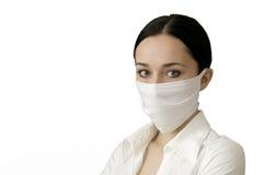 De mooie vrouwen in een medisch masker Stock Fotografie