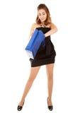 De mooie vrouwen met papper doen in zakken Stock Afbeeldingen