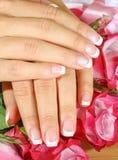 De mooie vrouwenhanden met namen toe Stock Fotografie