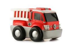 De motorstuk speelgoed van de brand