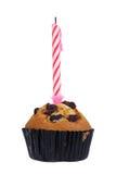 De muffin van de rozijn met kaars Stock Fotografie