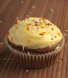 De muffinglans van de chocolade Stock Afbeeldingen