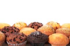 De muffinkop koekt grens witte achtergrondexemplaarruimte Stock Afbeeldingen