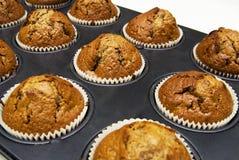 De muffins van de peperkoek in koppen Stock Afbeeldingen