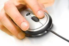De muis van de computer met hand Stock Foto