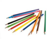 De multi-coloured potloden lagen stock afbeelding