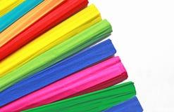 De multi gekleurde broodjes van omfloersen uit gewaaid document stock fotografie