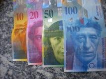 De munt van Swissfrancs van bankbiljetten Stock Foto