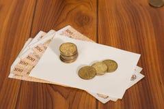 De muntstukken liggen op de kaart Royalty-vrije Stock Fotografie