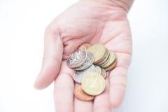 De muntstukken van de handholding Stock Fotografie