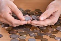 De muntstukken van de handholding Royalty-vrije Stock Afbeelding