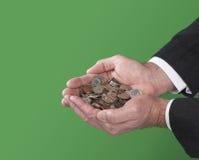 De muntstukken van de mensenholding royalty-vrije stock afbeelding