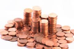 De muntstukken van de stapel die op wit worden geïsoleerdo Stock Foto