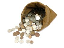 De muntstukken van het geld in zak Stock Foto