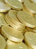 De muntstukken van het pond Stock Foto's