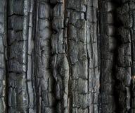De muur van Buirned Stock Foto's