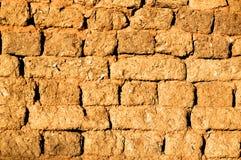 De muur van de adobe Stock Foto's