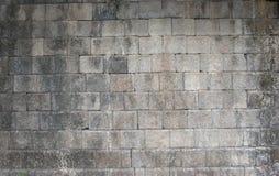 De muur van de baksteensteen grijze ruwe textuur als achtergrond Stock Foto
