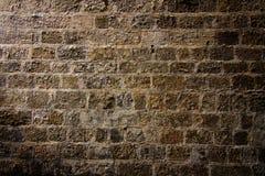 De muur van de steen in schijnwerper Stock Foto