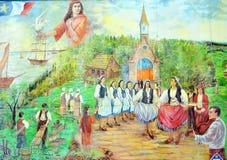 De muurschildering vertelt verhaal van acadiansmensen Stock Foto's