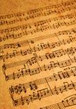 De Muziek van het blad op Perkament Stock Foto