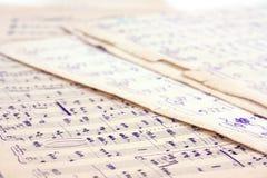 De muzieknota's van het document Stock Fotografie