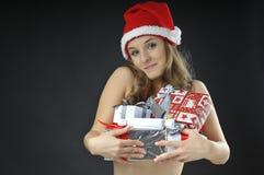 De naakte meisje behandelde giften van Kerstmis Stock Afbeelding