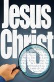 De naam Jesus Christ onder observatie met vergrootglas stock afbeelding