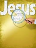 De naam JESUS onder observatie met vergrootglas stock fotografie