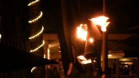 De Nacht van gastiki light torches burning in stock videobeelden