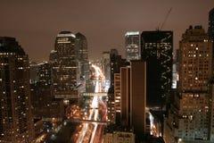De nacht van Manhattan Stock Afbeeldingen
