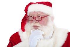 De nadenkende Kerstman royalty-vrije stock afbeelding