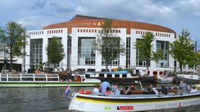 Dutch National Opera, Amsterdam, Netherlands. De Nationale Opera, Dutch National Opera, opera, Amstel Canal, Amsterdam, Holland, Netherlands stock footage