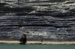 De natuurlijke achtergrond van de rotstextuur op de kust Royalty-vrije Stock Foto
