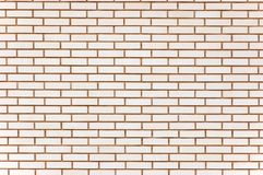 De natuurlijke beige fijne achtergrond van de bakstenen muurtextuur Stock Fotografie