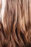 De natuurlijke bruine achtergrond van de haarclose-up royalty-vrije stock foto's