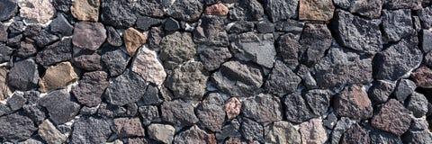 De natuurlijke donkere achtergrond van de steenmuur Stock Foto