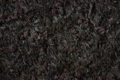 De natuurlijke zwarte close-up van de steentextuur, donkere grijze muurachtergrond Royalty-vrije Stock Afbeeldingen