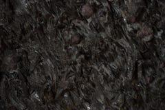 De natuurlijke zwarte close-up van de steentextuur, donkere grijze muurachtergrond Stock Foto